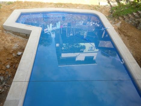 Piscina en cemento y liner permax con jacuzzi incorporado for Piscinas con jacuzzi precio